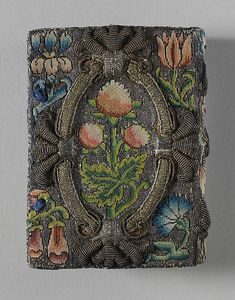 Book cover - English ca 1635. Canvas worked with silk and metal thread, seed pearls; tent, Gobelin, and couching stitches.