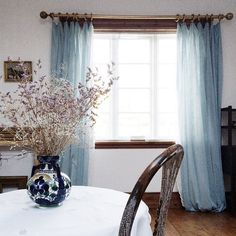 The beautiful blue curtains in Anna Ancher's studio - this is where she painted 'Interior with clematis' in 1913.