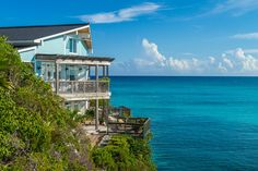 In spite of its name, there's no suspense at Cliffhanger. The oceanfront villa's charms are immediately obvious: its gorgeous setting on the shores of Winding Bay, lush landscaping, ample outdoor living areas and open-plan interiors.