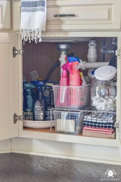 12 Amazing Kitchen Sink Organization Ideas Having a clean and organized kitchen eases your tasks much better than a cluttered one. These are my 12 amazing kitchen sink organization ideas to help you! Under Kitchen Sink Organization, Under Sink Storage, Kitchen Storage, Organized Kitchen, Refrigerator Storage, Cabinet Storage, Pantry Storage, Cabinet Ideas, Bathroom Storage