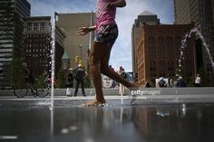 A child plays in a fountain in Public Square, in front of a painting of Donald Trump, presumptive 2016 Republican presidential nominee, ahead of the Republican National Convention (RNC) in Cleveland, Ohio, U.S., on Sunday, July 17, 2016. A key Republican National Convention committee crushed a long-shot attempt by rogue delegates to block Donald Trump's nomination, as internal strife that's roiled the party for much of the past decade was on full display Thursday amid fights over governing…