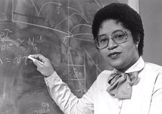 An image of Dr. Euphemia Lofton Haynes standing by a blackboard. She was the first African American woman to earn a PhD in Mathematics. She also held a PhD in philosphy as well....