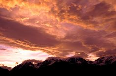 Clouds light up over Rocky Mountain National Park near Estes Park, Colorado.  --mike berenson photography