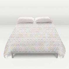 "Sleep and dream of colours with our ""Pastel triangles pattern"" duvet cover*. This geometric duvet cover will lighten up any room. It is also a perfect gift for any kid.  • Available in Full, Queen and King Size • Hand sewn and meticulously crafted • Soft white reverse side • Decorative microfiber duvet cover • Hidden zipper offers simple assembly for easy care • Individually cut and sewn by hand • Finished with a concealed zipper"