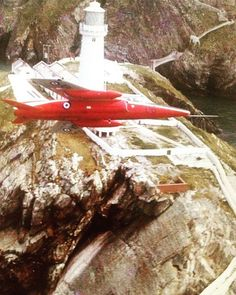 Heres a fab photo of a gnat sent to me some years ago flying over #southstacklighthouse #holyhead #anglesey in the 60s I believe #anglesey #raf Anglesey, Lighthouse, Holi, Bell Rock Lighthouse, Light House, Lighthouses, Holi Celebration