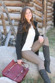 Gold coated metallic skinny jeans with a simple ivory button down top under a black coat. Pair with tall boots and red pyramid studded bag for a chic and functional outfit.    Valleygirl Boutique