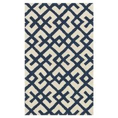 Bring a touch of exotic appeal to your living room or master suite with this hand-tufted wool rug, showcasing a trellis motif for eye-catching appeal.    Product: RugConstruction Material: WoolColor: Ivory and navyFeatures:  Hand-tuftedMade in India Note: Please be aware that actual colors may vary from those shown on your screen. Accent rugs may also not show the entire pattern that the corresponding area rugs have.Cleaning and Care: Clean spills immediately by blotting with a clean ...