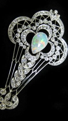 Antique platinum pin/pendant with European cut diamonds and opal. #opal #pendant #jewelry