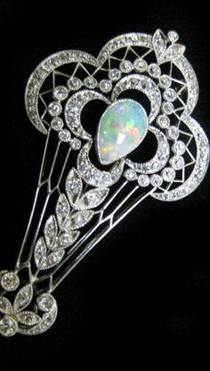 Antique platinum pin/pendant with European cut diamonds and opal. #opal #pendant #jewelry
