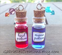 Health or Mana liquid potion in a miniature glass bottle pendant.  Awesome gamer gift idea! Choose the potion you need, or place a double order for both necklaces.  ♥ Size (height): 3.4cm without the cork, 3.8cm including the cork ♥ Mini glass bottles, liquid, glass crystal beads. Comes on a ...