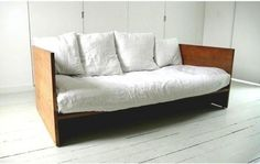 Daybed. $3900 (futon not included). I once had a daybed that looked much like this one. My dad and I made it. You can make one, too, and it won't cost 4k.