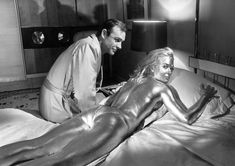 Sean Connery and Shirley Eaton on Goldfinger'set. Has JB said a golden joke ?