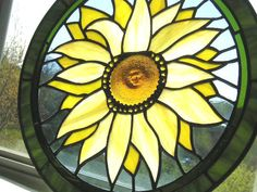 Stained Glass|Stained Glass Panel|Sunflower|Round Sunflower PanelStained Glass Sunflower|Glass|Yellow|Green|Blue|Handcrafted|Made in USA by CreativeSpiritGlass on Etsy https://www.etsy.com/listing/98839912/stained-glassstained-glass