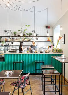 24 Hours in Ljubljana, Slovenia The colored corrugated metal used on the bar gives a fun and retro twist to this scheme Bar A Vin, Café Bar, Restaurant Design, Restaurant Bar, Kaffee To Go, Deco Cafe, Cafe Counter, Cafe Interior Design, Coffee Shop Design