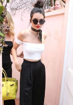 Kendall Jenner in white off the shoulder and high waisted pants. Killer!