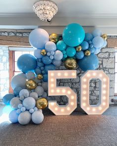 Balloons By Dina on Beautiful hues of blue for this stylish birthday. Balloons by us balloonsbydina Lightup Numbers by marqueeletterstoronto 50th Birthday Balloons, 50th Birthday Party Games, 50th Birthday Party Decorations, Moms 50th Birthday, 50th Birthday Cards, 50th Party, Blue Party Decorations, Blue Birthday, Birthday Month
