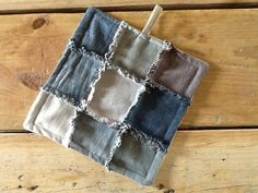My first decent sewing project:  DIY recycled jeans potholder.