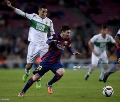 Barcelona's Argentinian forward Lionel Messi (R) vies with Elche's FC Elche's French midfielder Faycal Fajr during the Spanish Copa del Rey (King's Cup) round of 16 first leg football match FC Barcelona vs Elche FC at the Camp Nou stadium in Barcelona on January 8, 2015. AFP PHOTO/ JOSEP LAGO