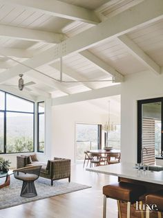 The architects preserved the existing beamed ceilings, which give the open-plan living area an airy feel. The living area is dressed with a vintage tête-à-tête sofa by Edward Wormley, a Warren Platner chair, and an Isamu Noguchi table. Home Renovation, Modern Interior, Interior Architecture, Roof Design, House Design, Portola Valley, 1960s House, White Beams, White Wood