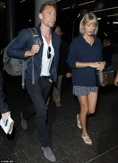 An Aus-some adventure: Taylor Swift and Tom Hiddleston were spotted at a Los Angeles airport as they got set to jet to Australia on Wednesday