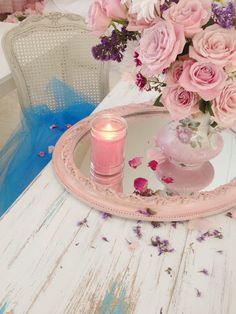 Add Pink candles or flowers. Another trick to add romance is to place mirrors under objects to emphasize them.