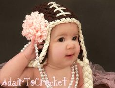 Chunky Crocheted Baby Football Hat With Attached Flower and Ear Flaps. Photo Prop by AdairToCrochet