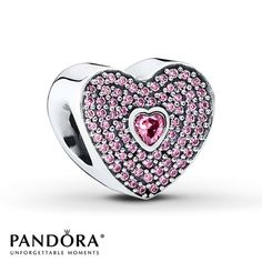 This lovely heart-shaped sterling silver charm from the PANDORA 2015 Valentine's Day collection features a heart-shaped pink cubic zirconia center surrounded by round pink cubic zirconias for a forget-me-not look. Style # USB792900.