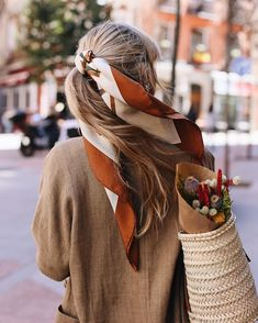How to keep your hair off your face: tie your hair back with a scarf.