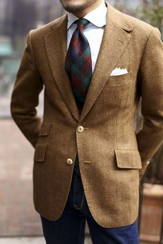 Light brown tweed jacket, white shirt, green, red, & navy plaid tie, navy pants