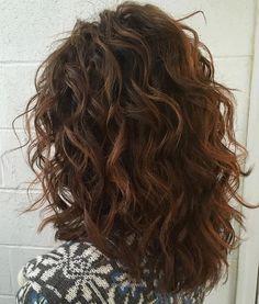 Mid-Length Curly Layered Haircut…