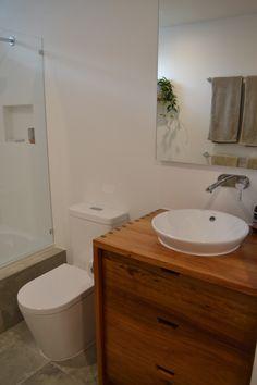 Timber (Tasmanian Blackwood) vanity with caroma Leda vasque inset basin. Custom built in mirrored cupboard. Gareth Ashton tap/spout. Recessed tiled shower shelf