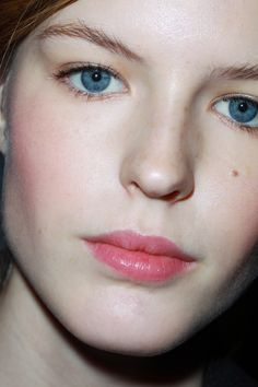 Pale skin, pink lips and rosy cheeks