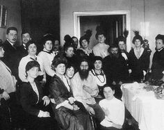 #Rasputin Grigori Jefimovitsj | Rasputin in his salon among admirers early 1914, most likely on his birthday; his father is the 4th from the right. His telephone is visible on the wall. Photo by Karl Bulla.
