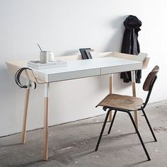 This EMKO table is luxuriously overpriced at 1250€ and I wouldn't like to dust it as often as the design requires, but the design is clear and appealing. I imagine cluttering it with loads and loads of undone paperwork will only add to its charm.
