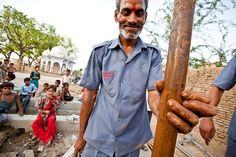 Water project mechanic Raju points out a small hole that had left the well in Sudamapuri Village unusable. His team hauled up 50 meters of piping to find it, filled the hole securely and put the pump head back on the well. In less than two hours, the community here had clean water access again. (photo: Mo Scarpelli)