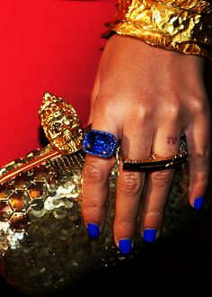 Beyonce + Her nails are blue and her IV tattoo showing beautifully on the finger that made her a Carter = Blue Ivy Carter