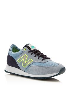 Find your groove in this retro-style sneaker from New Balance, emboldened with a mix of textures, colors, and bright logo detail.   Suede and mesh upper, textile lining, rubber sole   Imported   Round
