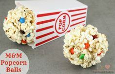 M&M Popcorn Balls combine the best movie night foods into a delicious handheld snack. These popcorn balls are filled with M&Ms chocolate candy for the perfect movie night snack.  - M&M's Popcorn Balls Recipe on Sugar, Spice and Family Life
