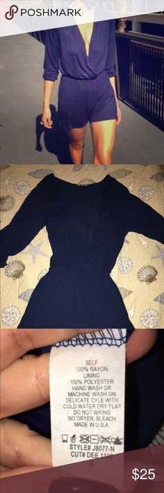 Navy blue low cut romper shorts (NWOT) This sexy navy blue low cut romper is great for the the summer or even a sexy date night. Low cut front with flared arms and shorts. With some high heels or flats looks great! ⭐️⭐️ if you have any questions feel free to ask! never been worn⭐️⭐️ Dee elle Shorts