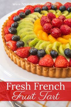 Fresh, colorful, and bursting with juicy fruit, rich pastry cream, a deliciously sweet pastry crust, and an easy fruit tart glaze, this French fruit tart recipe makes a showstopper dessert that is perfect for Spring & Summer! #fruit #tart #pastrycream #tartcrust #shortcrust #dough #glaze #French #pastry #dessert #summer #spring #strawberry #raspberry #berries #patesucree #cremepatisserie #patisserie