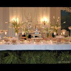 gold and silver wedding reception | tiffany blue and purple wedding wedding band on table dark blue light ...