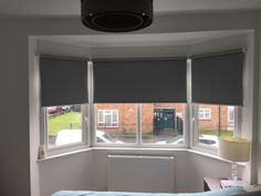 Made to measure blackout roller blinds installed for a bedroom bay window in Croydon. http://www.theblindshop.com
