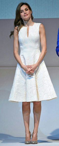 Letizia - white floral textured dress by Carolina Herrera. The sleeveless dress features a split collar and fit-and-flare skirt - snakeskin pumps by Magrit