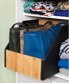 Purses organized in closet bin