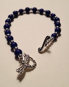 Spring 2013 collection; Blue hummingbird bracelet made with blue glass beads, silver spacer beads and a silver dragonfly toggle clasp.  $24.99