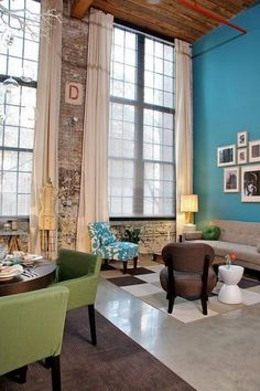 Love the colors, high ceilings and exposed brick