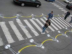 To encourage the city of Montreal to build more bike lanes, street artist Peter Gibson aka 'Roadsworth' started a guerrilla street art. Street Marketing, Guerilla Marketing, Viral Marketing, Passage Piéton, Pedestrian Crossing, Road Markings, Street Art Utopia, Zebra Crossing, Banksy