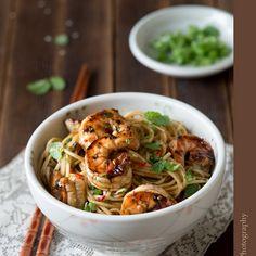 Asian Noodle Salad Recipe Salads with soy sauce, rice vinegar, large garlic cloves, honey, chili pepper, toasted sesame oil, chopped cilantro, lime, ginger, sesame seeds, shrimp, soba noodles, scallions, mint leaves