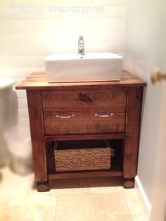 Remodelaholic » Blog Archive DIY Bathroom Vanity How To » Remodelaholic - Very cool cut out in the drawer to accomodate the plumbing