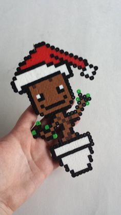 Product Details:  This is a 100% handmade Groot Christmas tree ornament! It is made out of plastic beads that have been fused together. It is